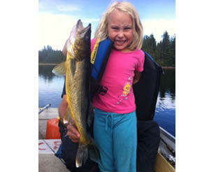 My daughter Thalie with a beautiful walleye...