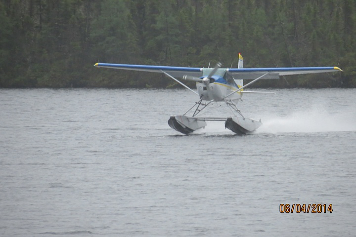 Mr. Glen's group picture from the Little Benny Lake. The Cessna take off...