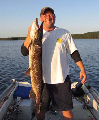 Brad Hahn on Bob lake Nice pike on the Sunset!