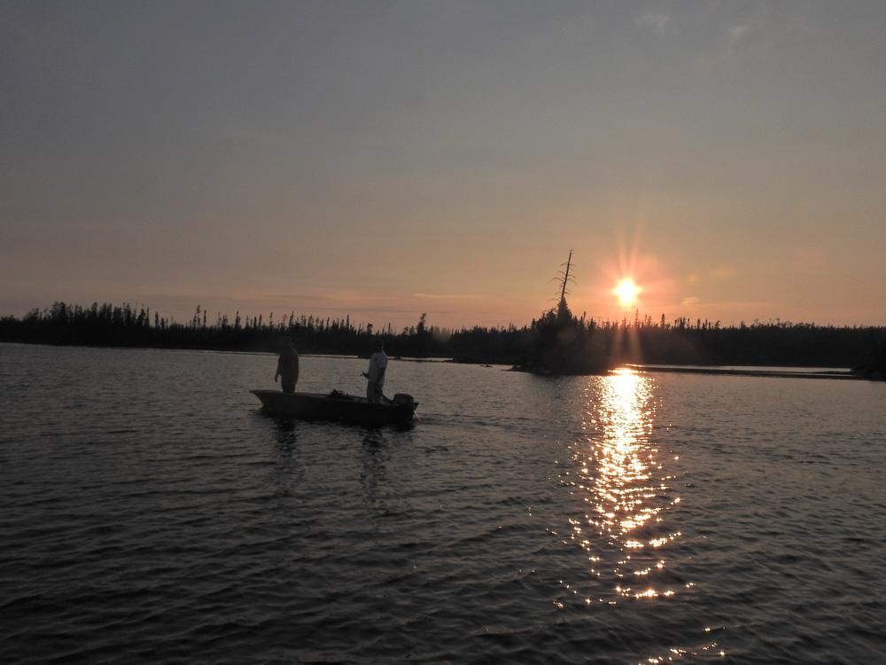 Fishing at sunset by John Romano